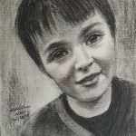 A3 charcoal drawing of young boy Max